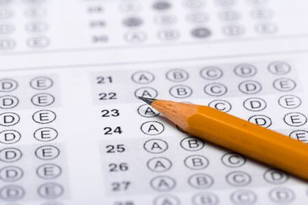pencil for the exam. printed school test Answer sheet Banco de Imagens