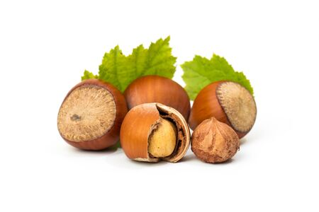 Hazelnuts with leaves isolated on a white background