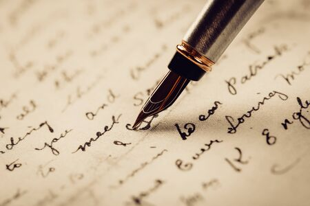 fountain pen on paper with ink text closeup Foto de archivo