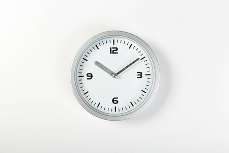 white with light metal minimalistic wall clock close-up on a light background Banque d'images