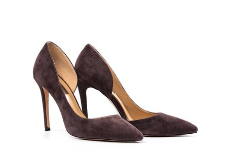 Stylish classic suede women's leather shoes with medium high heels on an isolated white background.