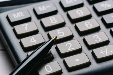 black calculator, Business and Finance accounting concept on wooden table Stockfoto