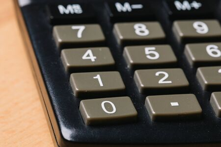 black calculator, Business and Finance accounting concept on wooden table Banque d'images