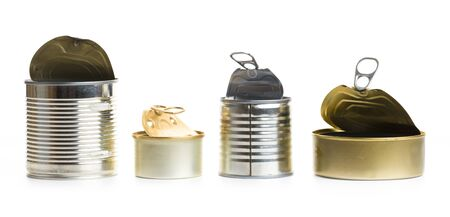 several open empty tin cans on a white background