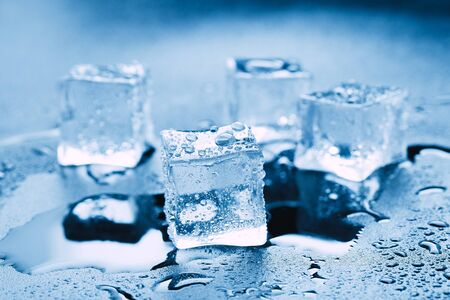 Ice cubes square with drops water clean on blue background. 스톡 콘텐츠 - 144799808
