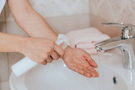 Hygiene concept. Washing hands with soap under the faucet with water Stock Photo