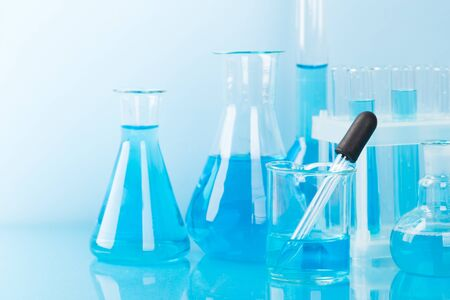 Laboratory glassware with a pipette and test tubes. scientific laboratory equipment