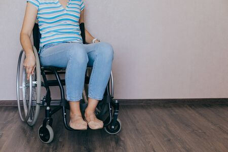 Disabled young girl. woman at home on a wheelchair. Recovery and healthcare concepts. Stok Fotoğraf