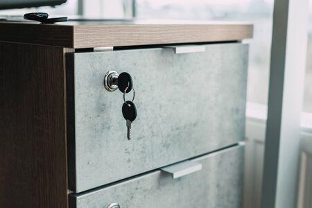Locked desk locker in a modern office. security concept