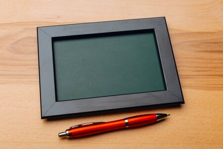Clean vintage chalk board on a wooden table. Top view 版權商用圖片