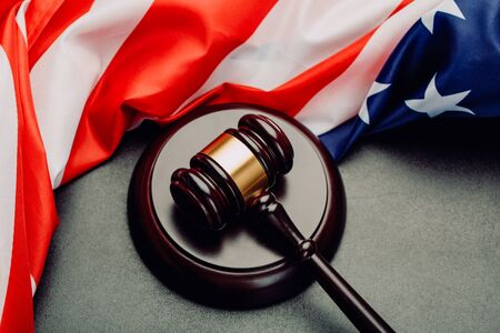 Judge gavel on the background of the flag united states of America