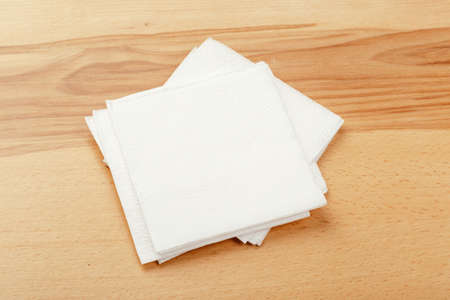 white paper napkin with a textured pattern on an old table