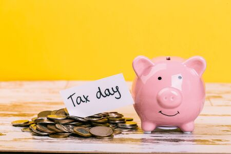 pink piggy bank on a yellow background, space for text. Finance, saving money, crisis. Business or Retirement Savings