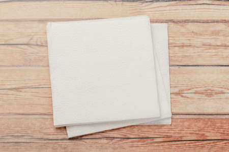 white paper napkin with a textured pattern on an old table Stock Photo