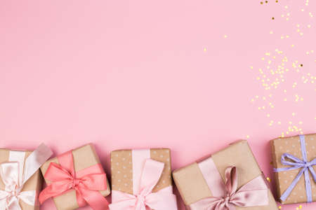 Gift or gift box and stars confetti on a pink table from above. Flat composition for birthday, mothers day or wedding. Stok Fotoğraf