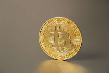 Bitcoins and new virtual money on plain gray background