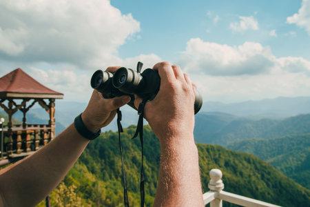 Looking through the binoculars. Concept of active travel