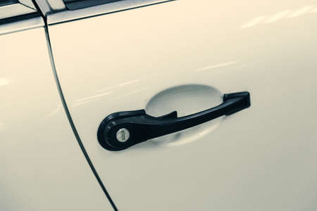 close-up of a door handle with a keyhole in a sports car