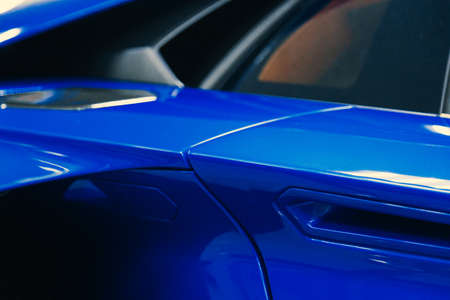 close-up of a blue modern sports car door handle Archivio Fotografico