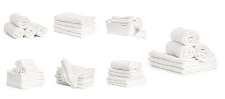 set of white terry towels isolated on white background