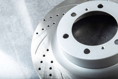 improved Perforated brake discs on a stone gray table