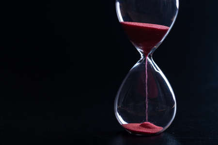 Sand glass, modern hourglass showing last second or last minute or time out. With copy space.