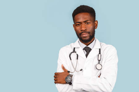 medicine, profession and healthcare concept. African American male doctor or scientist in white coat against blue background Archivio Fotografico