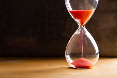 Hourglass as a concept of passing time for business deadline, urgency and outcome of time.