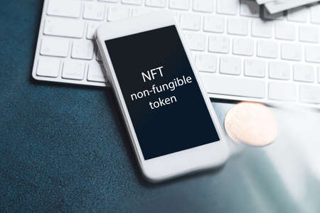 NFT non - fungible tokens inscription in the art frame. A non-fungible token (NFT) is a special type of cryptographic token which represents something unique. 免版税图像