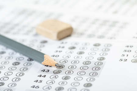 testing in exercise and exam paper. computer sheet with pencil in school test room, education concept. filling in answers in pencil