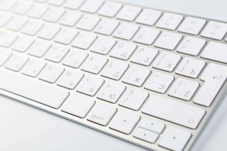Aluminum computer keyboard wireless connection. Beautiful modern design, isolated on white background. close up view 版權商用圖片