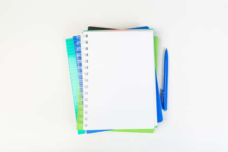 top view of open notebook with pen on gray background, school notebooks with coil spring, office notebook flat lay 版權商用圖片
