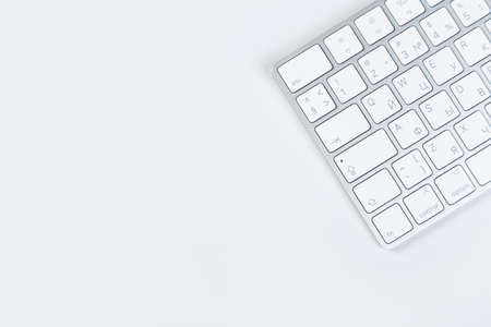 Aluminum computer keyboard wireless connection. Beautiful modern design, isolated on white background. close up view Фото со стока