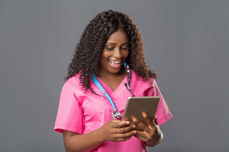 An African doctor consults a patient, makes a video call from a webcam on the tablet screen. Telemedicine videoconference remote computer application virtual meeting.