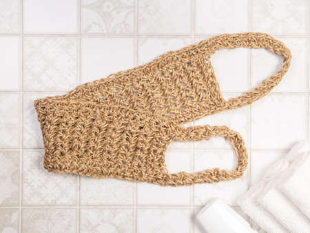 bath sponges for the body, soap and towels on a light background. eco-friendly natural bathroom accessories Фото со стока