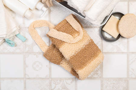 natural materials for bathroom accessories. bath sponges, washcloths, soap and towels on a light background. 스톡 콘텐츠
