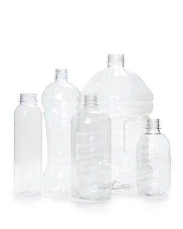 many different empty plastic bottles isolated on white background. production of new containers 스톡 콘텐츠