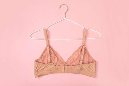 inside stylish bra for women on pink background