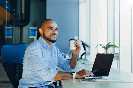 Handsome cheerful african american executive business man in startup office Фото со стока