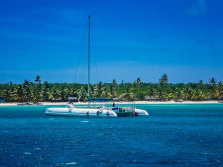 Saona Island, Dominican Republic. Landscape Of A Beautiful Beach With A Catamaran. Travels