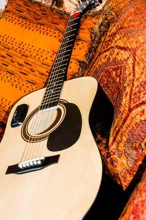Lonesome guitar waiting for a musician Фото со стока