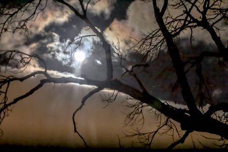 Eerie sunset moon in Peruvian sky Фото со стока - 70724677