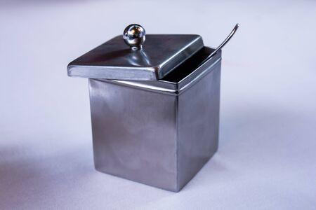 Silver sugar bowl, with silver spoon, in an elegant restauran