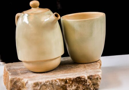 Simple ceramic Pot of coffee with  a cup Фото со стока