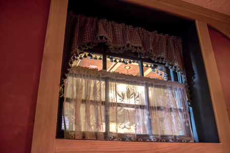 albuquerque america antique atmosphere beige below cafe check curtains decorated decorative fabric fashioned material net old paintwork pelmet red restaurant retro states tassels united walls window Фото со стока