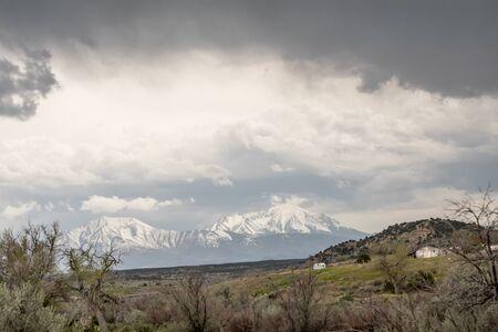 Cold Colorado sky over frozen icy mountain Фото со стока