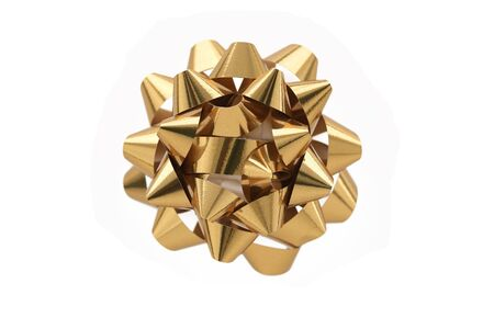 A horizontal color photo of a gold gift wrap bow isolated over a white background.
