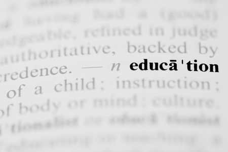 The word education as a dictionary entry in a horizontal photograph. Stock Photo