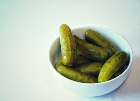 Pickles in white bowl high angle shot Stock fotó
