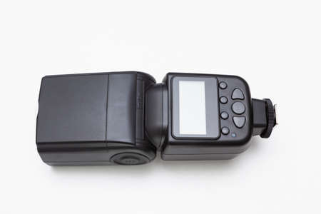 Wireless speedlite flash for photography on white background. It has a display screen and seven gray buttons for different functions.